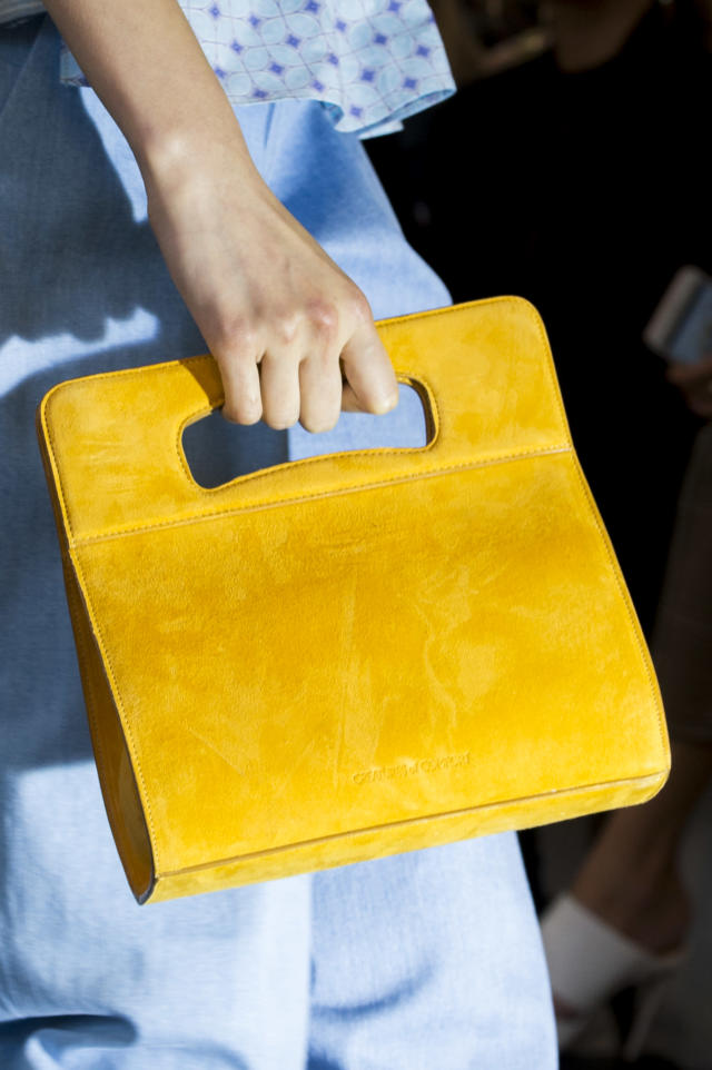 <p><i>Yellow suede handbag from the SS18 Creatures of Comfort collection. (Photo: ImaxTree) </i></p>