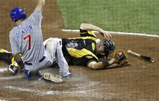 Chicago Cubs' Brett Jackson (7) scores as Pittsburgh Pirates catcher Rod Barajas (26) loses the ball on the throw from first baseman Gaby Sanchez in the sixth inning of a baseball game Friday, Sept. 7, 2012, in Pittsburgh. (AP Photo/Keith Srakocic)