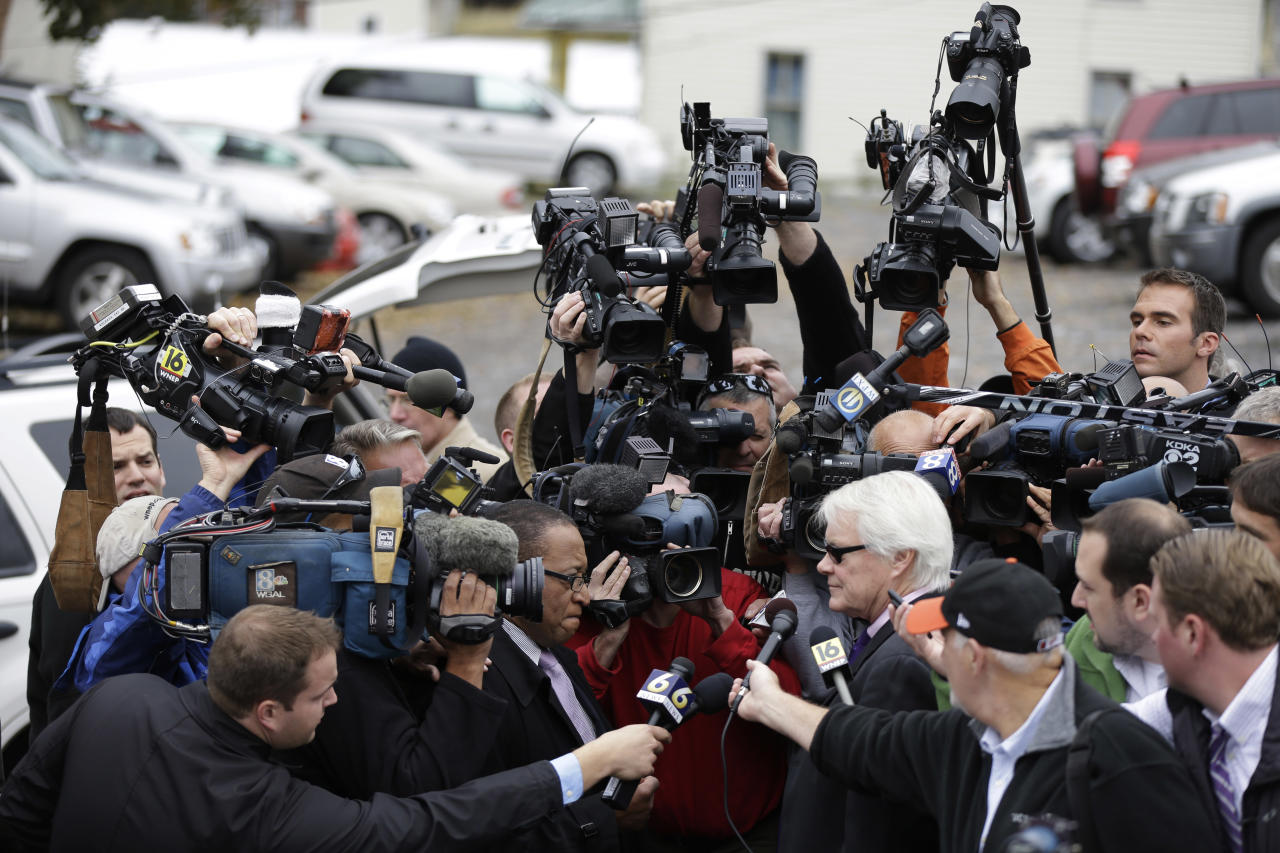 Pennsylvania senior Deputy Attorney General Joseph E. McGettigan III speaks with members of the media after a pre-sentencing conference at the Centre County Courthouse, Monday, Oct. 8, 2012, in Bellefonte, Pa. Former Penn State University assistant football coach Jerry Sandusky is scheduled to be sentenced Tuesday for sexually abusing 10 boys in a scandal that rocked the university and brought down coach Joe Paterno. (AP Photo/Matt Rourke)