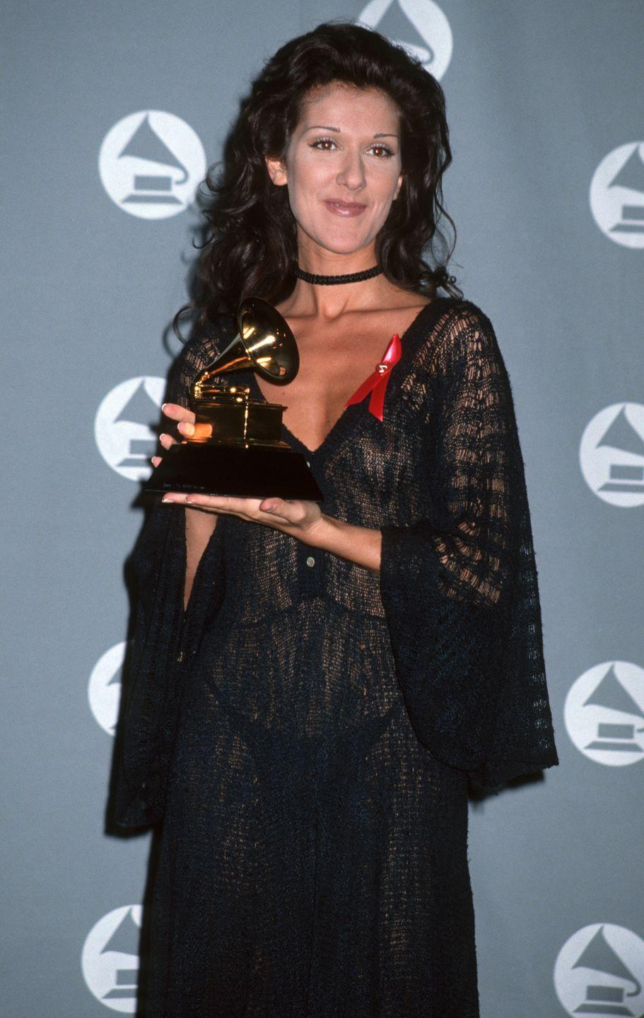 <p>The singer really went for it in a completely sheer black gown that showed off nothing but a black thong underneath at the Grammys. In true '90s fashion, she accessorized the look with a black choker. </p>