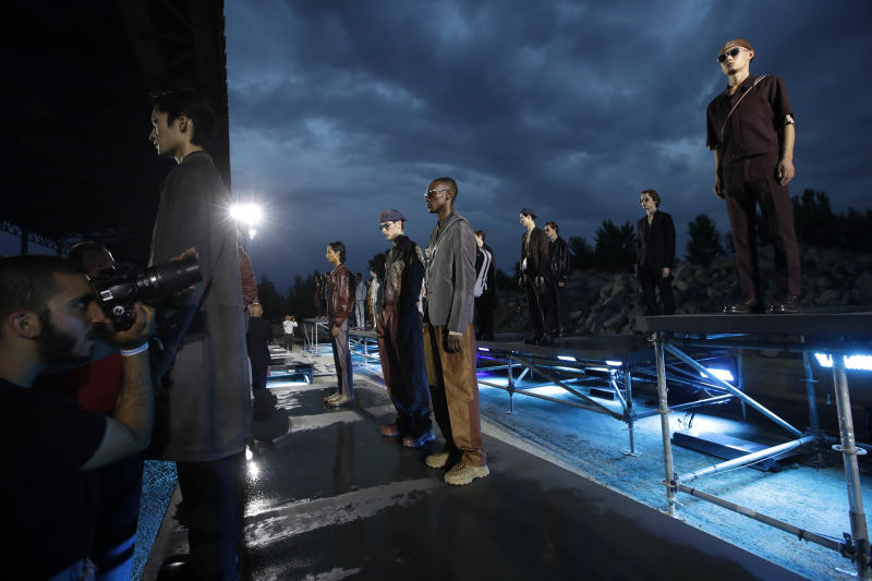 Models are photographered wearing creations as part of the Ermenegildo Zegna men's Spring-Summer 2020 collection, unveiled during the fashion week, in Milan, Italy, Friday, June 14, 2019. (AP Photo/Luca Bruno)
