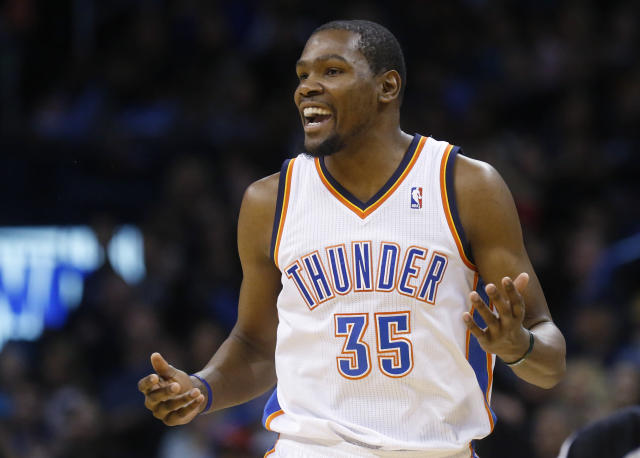 Oklahoma City Thunder forward Kevin Durant (35) smiles after hitting a basket in the second quarter of an NBA basketball game against the Portland Trail Blazers in Oklahoma City, Tuesday, Jan. 21, 2014. (AP Photo/Sue Ogrocki)