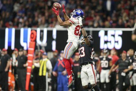 Oct 22, 2018; Atlanta, GA, USA; New York Giants wide receiver Sterling Shepard (87) catches a pass over Atlanta Falcons cornerback Robert Alford (23) in the second quarter at Mercedes-Benz Stadium. Mandatory Credit: Brett Davis-USA TODAY Sports