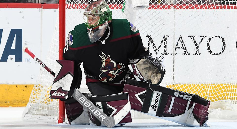 GLENDALE, ARIZONA - JANUARY 04: Antti Raanta #32 of the Arizona Coyotes gets ready to make a save against the Philadelphia Flyers at Gila River Arena on January 04, 2020 in Glendale, Arizona. (Photo by Norm Hall/NHLI via Getty Images)