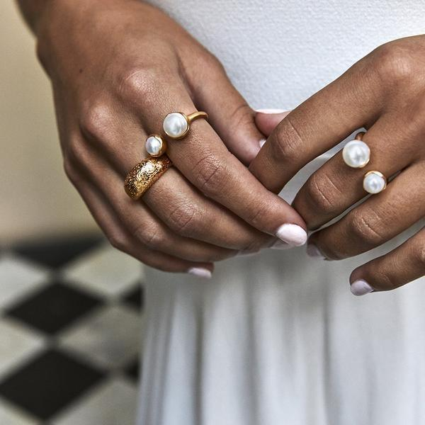 "<p>""There's something so dreamy about a pearl ring. I loved how ethereal this <span>Fairley Double Pearl Ring</span> ($177) looked from the moment I saw it on the brand's website. It's a fun way to dress up, even if I'm just wearing sweats.""</p>"