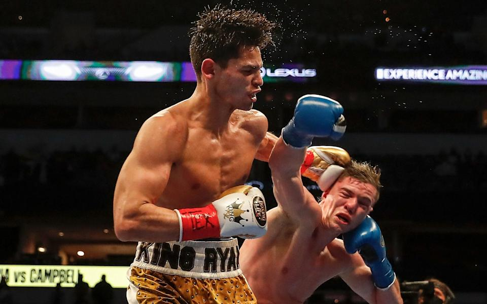 Ryan Garcia (L) lands a left hook agains Luke Campbell during the WBC Interim Lightweight Title fight at American Airlines Center on January 02, 2021 in Dallas, Texas - Getty Images North America/Tim Warner
