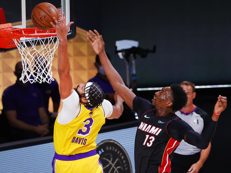 Anthony Davis #3 of the Los Angeles Lakers and Bam Adebayo #13 of the Miami Heat fight for a rebound during the first quarter in Game One of the 2020 NBA Finals