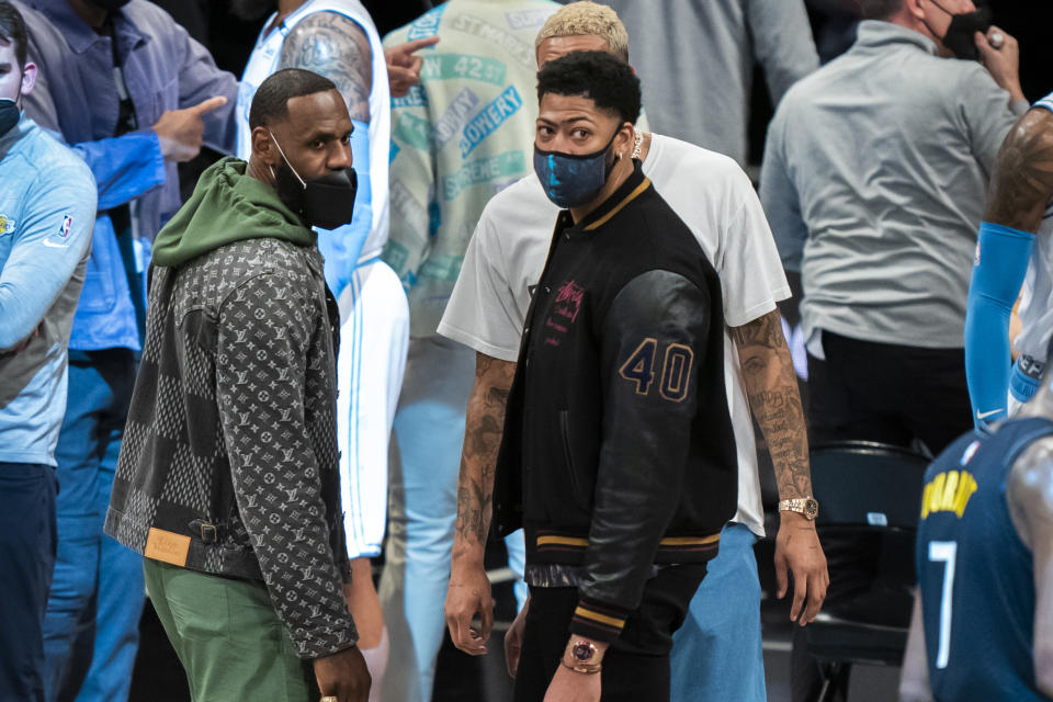 Los Angeles Lakers forward LeBron James and forward Anthony Davis look on during a time out  in the second half of an NBA basketball game against the Brooklyn Nets, Saturday, April 10, 2021, in New York. (AP Photo/Corey Sipkin)