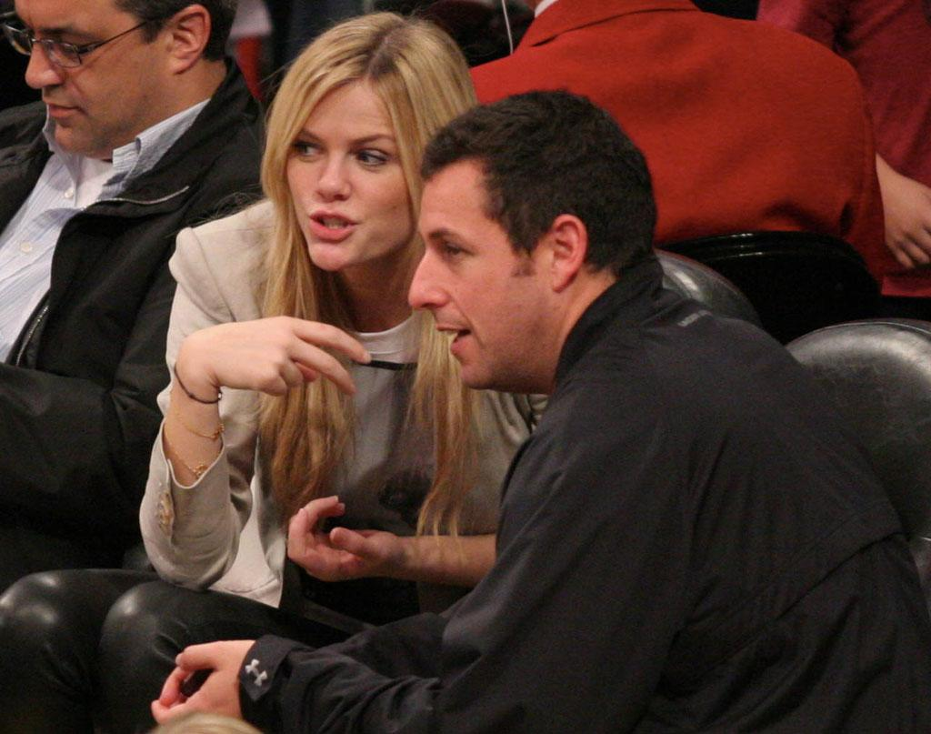 """Adam Sandler and his """"Just Go With It"""" co-star Brooklyn Decker (who is married to tennis champ Andy Roddick) were on hand to watch the game -- and promote their new comedy, which hits screens February 11. London Entertainment/<a href=""""http://www.splashnewsonline.com"""" target=""""new"""">Splash News</a> - January 30, 2011"""