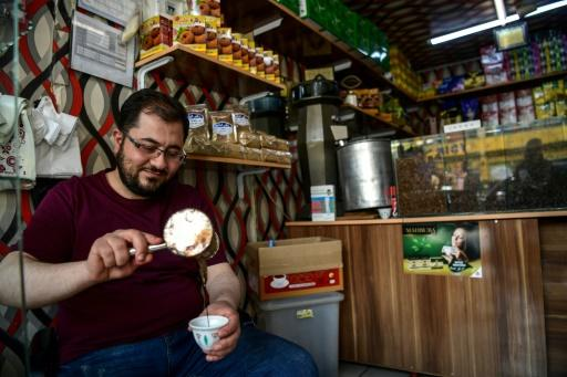 A Syrian coffee seller pours the black liquid in the Turkish city of Gaziantep, home to around half a million Syrians who fled the civil war south of the border