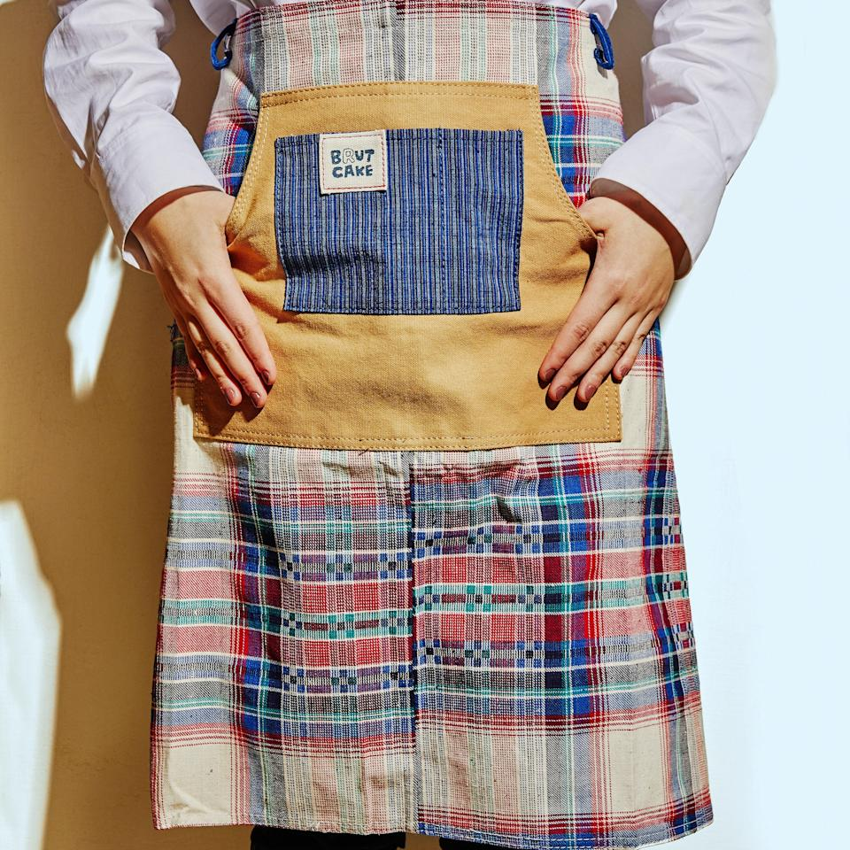 """<p>""""Mothers in China used to weave special family fabrics for their daughters' dowries. Brut Cake collects these vintage fabrics from all over China and upcycles them into something we can use again, like these cotton aprons, which keep you looking great during <em>and</em> after you bake.""""</p> <p><em>Buy it:</em> <a href=""""https://www.sage-collective.com/all-collections/cotton-half-waist-apron-with-pockets-plaid"""" rel=""""nofollow noopener"""" target=""""_blank"""" data-ylk=""""slk:Cotton Half Waist Apron with Pockets, $50"""" class=""""link rapid-noclick-resp""""><em>Cotton Half Waist Apron with Pockets, $50</em></a></p>"""
