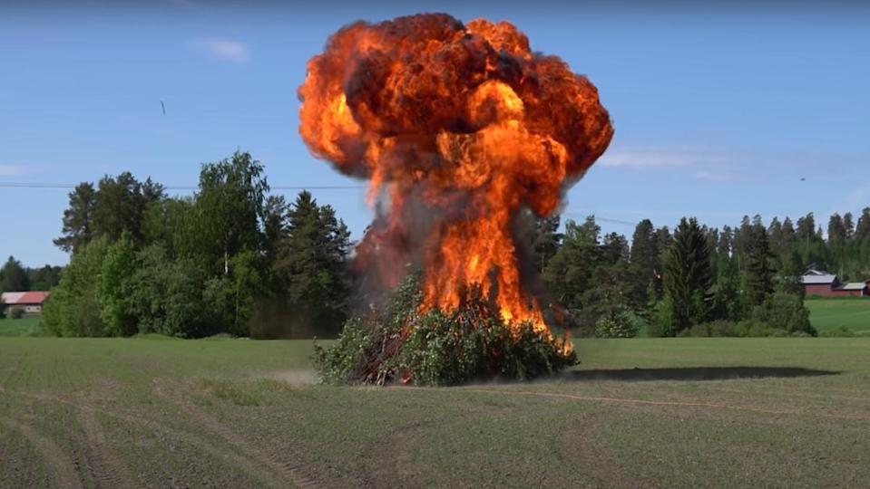 A gasoline bonfire in the midst of exploding into a massive, flaming mushroom cloud.