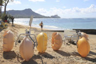 Watercraft vehicles sit on Waikiki Beach waiting to be rented Thursday, Oct. 15, 2020, in Honolulu. A new pre-travel testing program will allow visitors who test negative for COVID-19 to come to Hawaii and avoid two weeks of mandatory quarantine goes into effect Thursday. The pandemic has caused a devastating downturn on Hawaii's tourism-based economy and many are hoping the testing will help the economy rebound. (AP Photo/Marco Garcia)