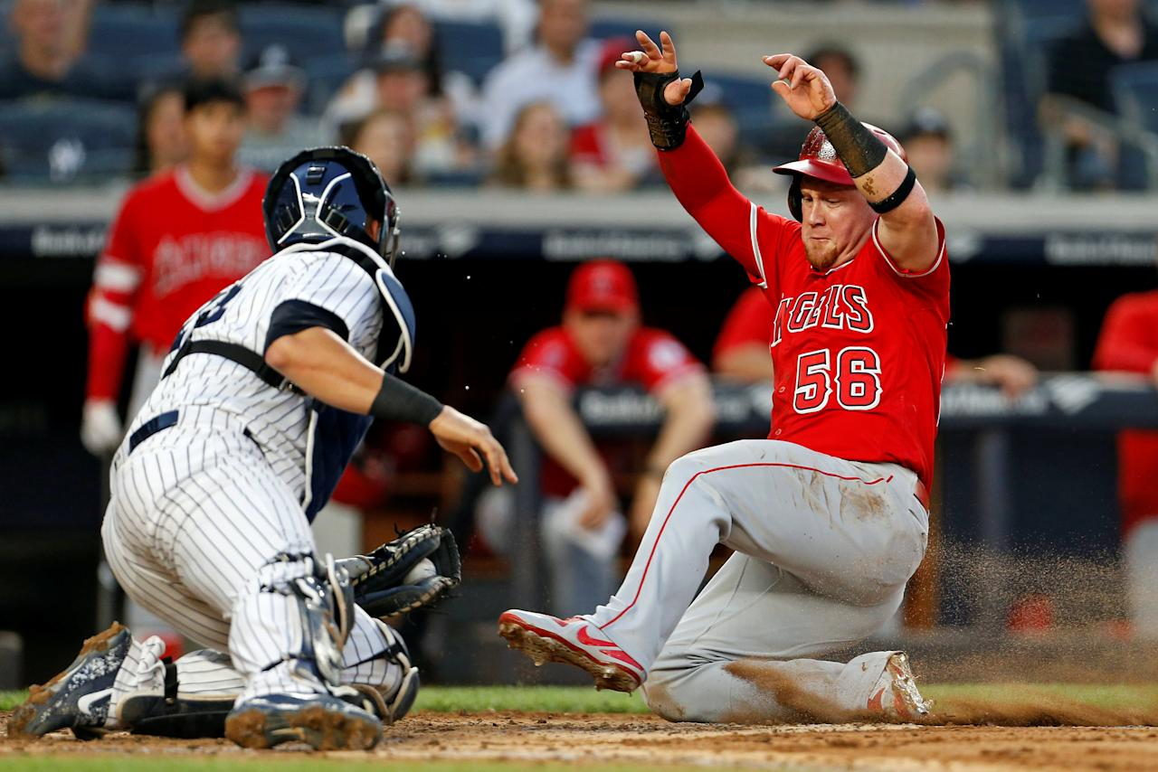 May 25, 2018; Bronx, NY, USA; Los Angeles Angels right fielder Kole Calhoun (56) is tagged out by New York Yankees catcher Gary Sanchez (24) during the third inning at Yankee Stadium. Mandatory Credit: Adam Hunger-USA TODAY Sports     TPX IMAGES OF THE DAY