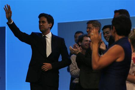 Britain's opposition Labour party leader Ed Miliband waves as he arrives to deliver his speech at the annual Labour party conference in Brighton, southern England September 24, 2013. REUTERS/Stefan Wermuth