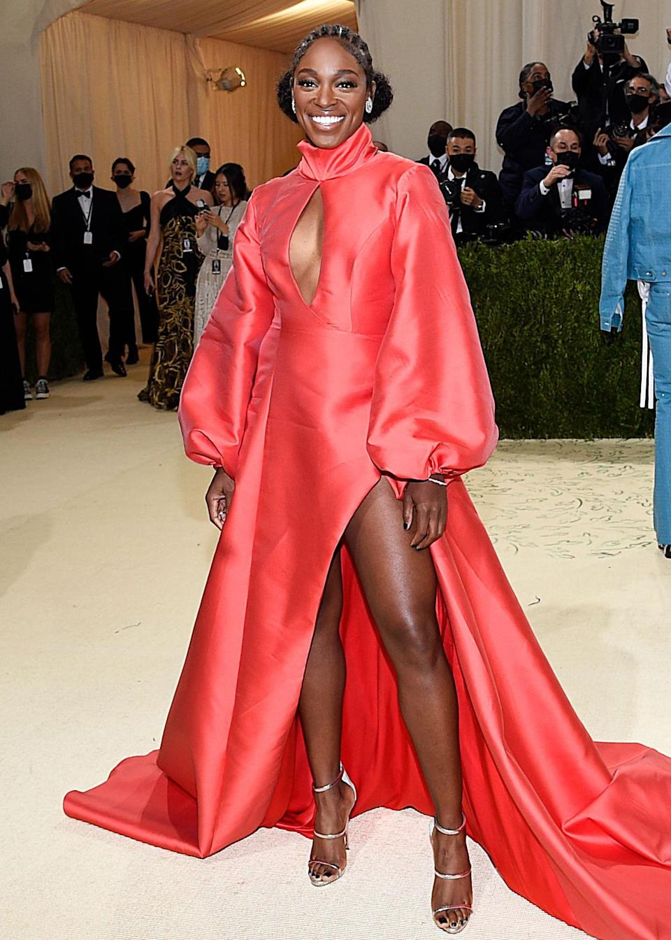 <p>Stephen's billowing red gown by ALIÉTTE looked perfect on the tennis star.</p>