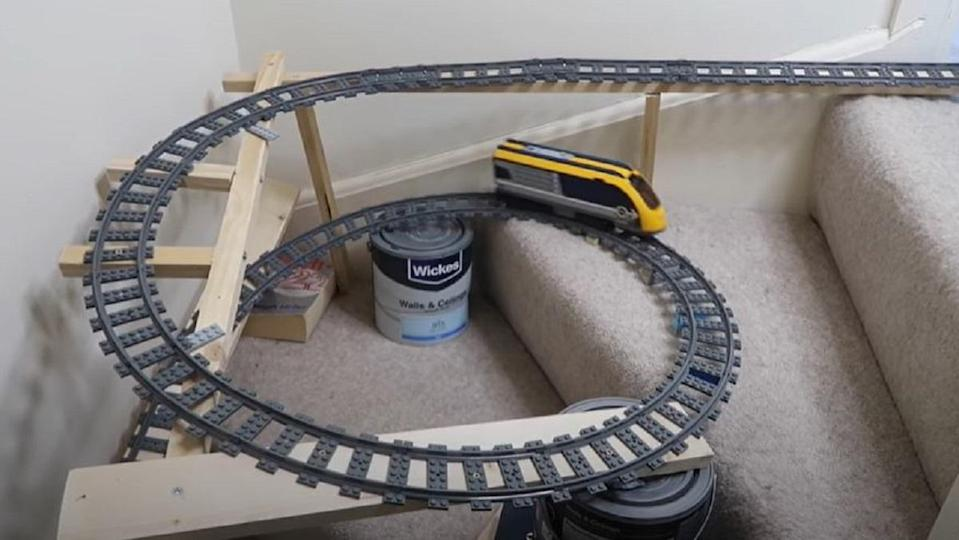 One man in the U.K. created a LEGO train set through his entire home.