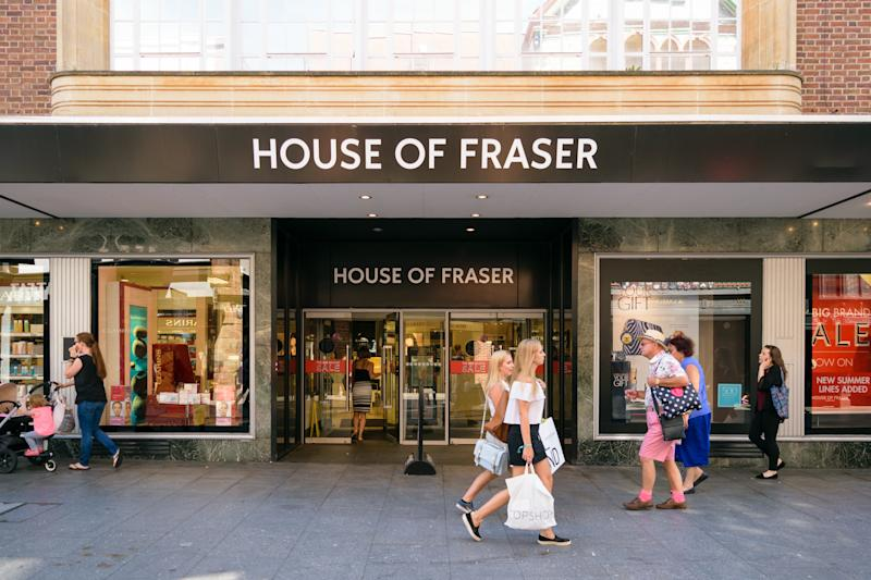 Exeter, Devon, United Kingdom - August 23, 2016: People pass by House of Fraser located on High street. House of Fraser is the third largest group of stores operating 60 shops in the UK.