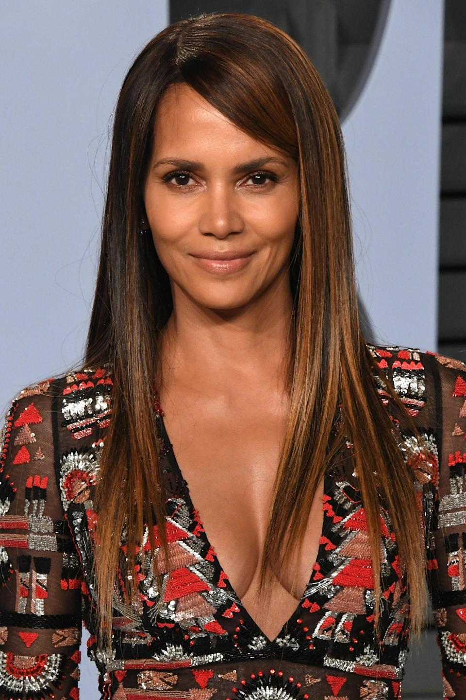 """<p>Halle Berry is now a household name, but it wasn't always that way. When she first hopped onto the Hollywood scene in the '90s, she became known for her pixie haircut. The interesting part is that she wasn't trying to make a statement with her hair, she just didn't want to risk hairstylists who didn't know how to do it.</p> <p>""""That's why I had short hair,"""" <a href=""""https://apnews.com/298c0720f9594d05aeffae26802c7ac6"""" rel=""""nofollow noopener"""" target=""""_blank"""" data-ylk=""""slk:she said in 2019"""" class=""""link rapid-noclick-resp"""">she said in 2019</a>. """"[Maintaining] it was easy. I think as people of color, especially in the business, we haven't always had people that know how to manage our hair. Those days are different now."""" Things have definitely improved, but as we've learned, they're not all that <em>different</em>.</p>"""
