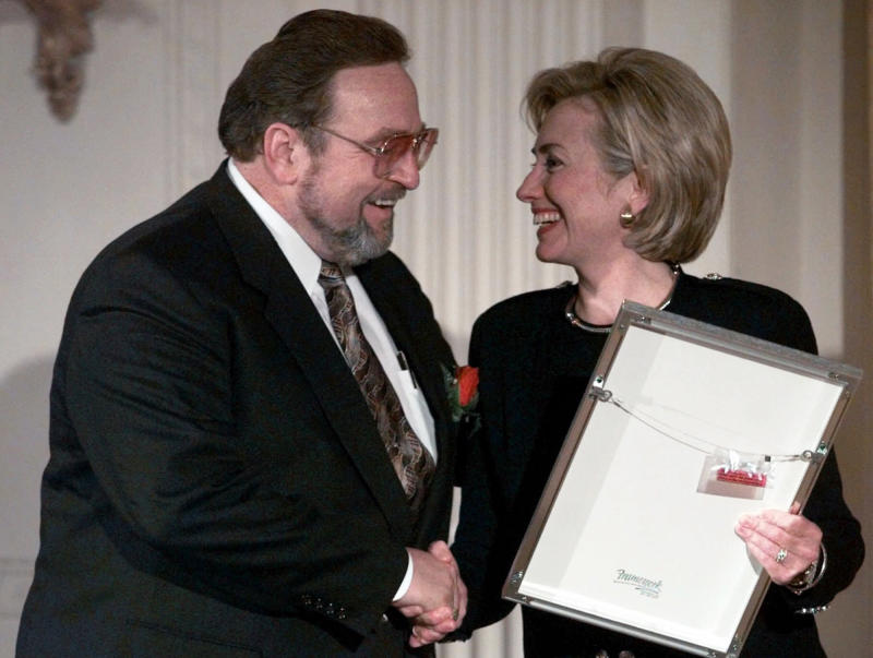 """FILE - In this Oct. 6, 1998 file photo, first lady Hillary Rodham Clinton shakes hands with Eddie Blazonczyk at the White House where she presented him with a National Endowment for the Arts 1998 National Heritage Fellowship award. Blazonczyk's record label, Bel-Aire Recordings, says Blazonczyk died Monday, May 21, 2012, of natural causes at a hospital Palos Heights, Ill. He was 70. Blazonczyk was known as the """"Polka King"""" and started his own polka music label in the 1960s. Blkazonczyk won a Grammy in 1987 for Best Polka Recording for """"Another Polka Celebration.""""  He retired in 2001 after suffering health problems. (AP Photo/Khue Bui, File)"""