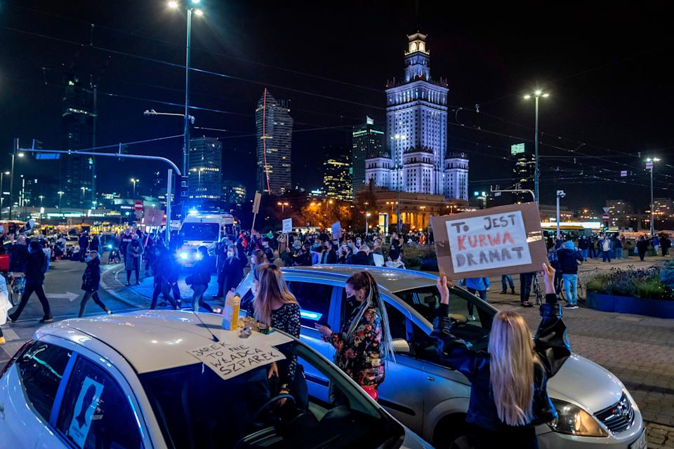 Scuffles erupted between protesters and far-right groups who broke through a police cordon separating them in front of a church in Warsaw (AFP via Getty Images)