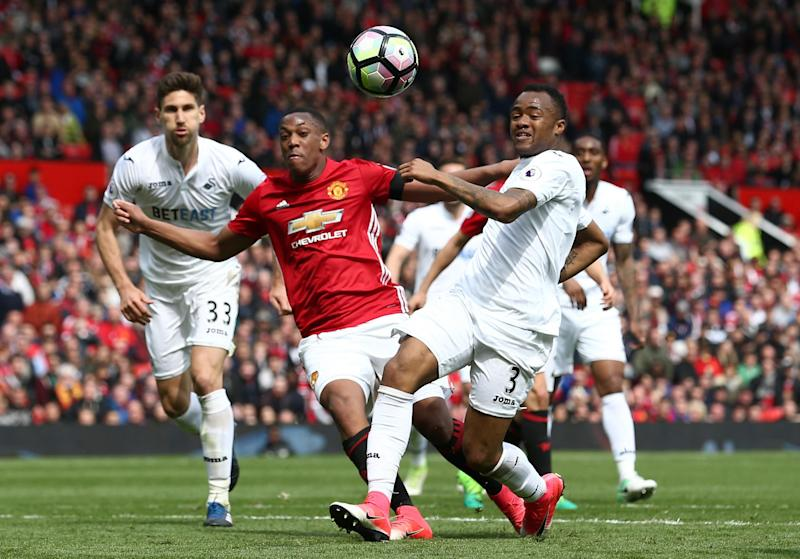 Swansea left Old Trafford with a hard-fought point: Getty