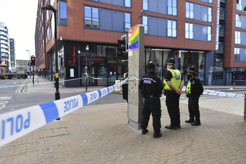 Police officers stand at a cordon in Hurst Street in Birmingham after a number of people were stabbed in the city centre on Sunday. Source: AP