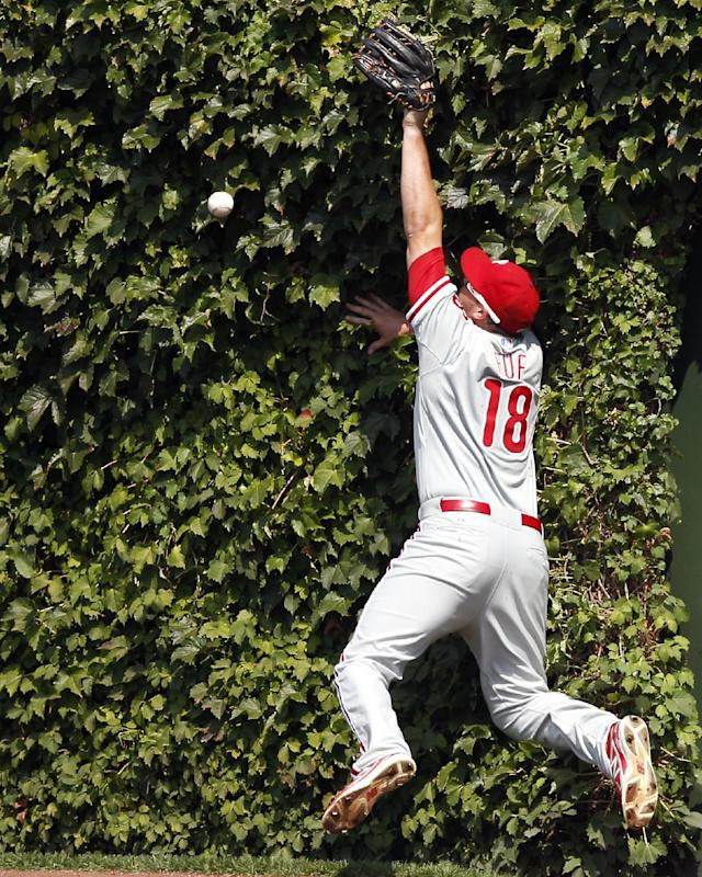Philadelphia Phillies right fielder Darin Ruf misses the catch on a double hit by the Chicago Cubs' Anthony Rizzo during the third inning of a baseball game on Sunday, Sept. 1, 2013, in Chicago. (AP Photo/Andrew A. Nelles)