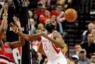 Feb 25, 2016; Portland, OR, USA; Portland Trail Blazers forward Maurice Harkless (4) knocks the ball away from Houston Rockets guard James Harden (13) during the fourth quarter of the game at the Moda Center at the Rose Quarter. Harden scored 46 points as the Rockets won the game 119-105. Mandatory Credit: Steve Dykes-USA TODAY Sports