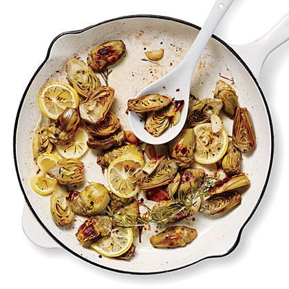"""<p>With a <a href=""""https://www.myrecipes.com/ingredients/vegetable-recipes/artichoke-recipes"""" rel=""""nofollow noopener"""" target=""""_blank"""" data-ylk=""""slk:subtly flavored ingredient like artichokes"""" class=""""link rapid-noclick-resp"""">subtly flavored ingredient like artichokes</a>, sometimes the simplest approach is best when preparing this side dish of Pan-Roasted Artichokes with Lemon and Garlic. A little roasted lemon, garlic, and fragrant rosemary are all you need to make tender baby artichokes shine.</p>"""