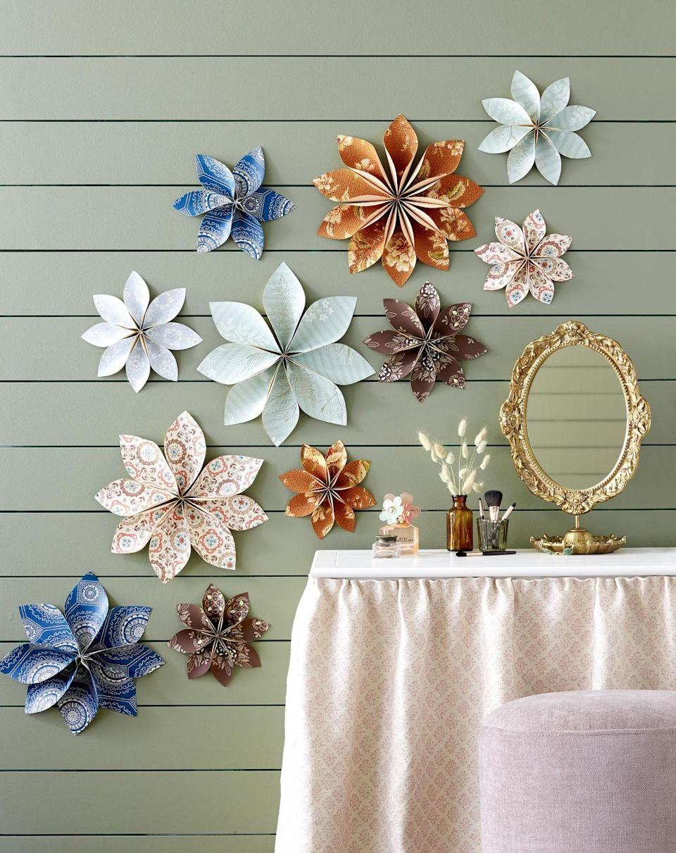 """Surround mom with DIY blooms made from colorful patterned wallpaper.<br><p><strong>To make</strong>: Transform wallpaper remnants into floating flowers. Trace and cut out 8 to 12 (depending on sizes) petals (see<br><em>countryliving.com/petal-template </em>for a template) on backs of wallpaper remnants. Pinch together one end of each petal, and secure with hot-glue. Once dry, glue petals together in a circle. Secure to wall with pushpins.<br><br><a class=""""link rapid-noclick-resp"""" href=""""https://go.redirectingat.com?id=74968X1596630&url=https%3A%2F%2Fwww.etsy.com%2Fsearch%2Fvintage%3Fq%3Dwallpaper%26bucket_id%3DiU16hZ2q7-mmyefOp9rDC4m8bukm%26user_id%3D57520233%26eligibility_map%255Bcurrency%255D%3DUSD%26eligibility_map%255Bdevice%255D%3D1%252C0%252C0%252C0%252C0%252C0%252C0%252C0%252C0%252C0%252C0%252C0%26eligibility_map%255Blanguage%255D%3Den-US%26eligibility_map%255Bregion%255D%3DUS%26eligibility_map%255Buser%255D%3D57520233%26vintage_rewrite%3Dvintage%2Bwallpaper%26original_query%3D2&sref=https%3A%2F%2Fwww.countryliving.com%2Fdiy-crafts%2Fg2357%2Fgifts-for-grandma%2F"""" rel=""""nofollow noopener"""" target=""""_blank"""" data-ylk=""""slk:SHOP VINTAGE WALLPAPER"""">SHOP VINTAGE WALLPAPER</a></p>"""