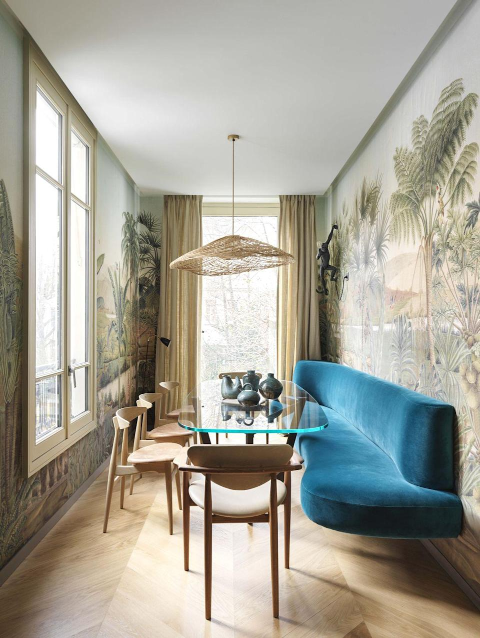 """<p>This less-than-ideally shaped dining area allowed design firm <a href=""""https://leberrevevaud.com/"""" rel=""""nofollow noopener"""" target=""""_blank"""" data-ylk=""""slk:Le Berre Vevaud"""" class=""""link rapid-noclick-resp"""">Le Berre Vevaud</a> to get creative with their clients' <a href=""""https://www.veranda.com/home-decorators/a30145144/le-berre-vevaud-paris-apartment/"""" rel=""""nofollow noopener"""" target=""""_blank"""" data-ylk=""""slk:19th-century Parisian loft"""" class=""""link rapid-noclick-resp"""">19th-century Parisian loft</a>, reinventing it into a delightful space to gather with loved ones over a meal or cocktail. Besson's panoramic wallpaper inspired by the Napoleonic campaigns in Egypt, enameled porcelain monkey sconces from <a href=""""https://www.seletti.it/us/"""" rel=""""nofollow noopener"""" target=""""_blank"""" data-ylk=""""slk:Seletti"""" class=""""link rapid-noclick-resp"""">Seletti</a>, and a hovering banquette draped in <a href=""""https://www.pierrefrey.com/en/"""" rel=""""nofollow noopener"""" target=""""_blank"""" data-ylk=""""slk:Pierre Frey"""" class=""""link rapid-noclick-resp"""">Pierre Frey</a> velvet make the room feel worlds away—certainly not between the Place de la Concorde and Élysée Palace.</p>"""