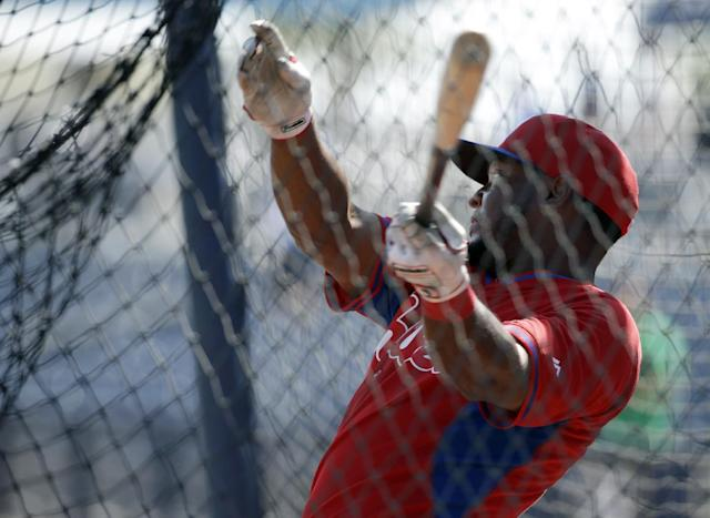 Philadelphia Phillies right fielder Leandro Castro takes batting practice before an exhibition baseball game against the Tampa Bay Rays, Monday, March 3, 2014, in Port Charlotte, Fla. (AP Photo/Steven Senne)