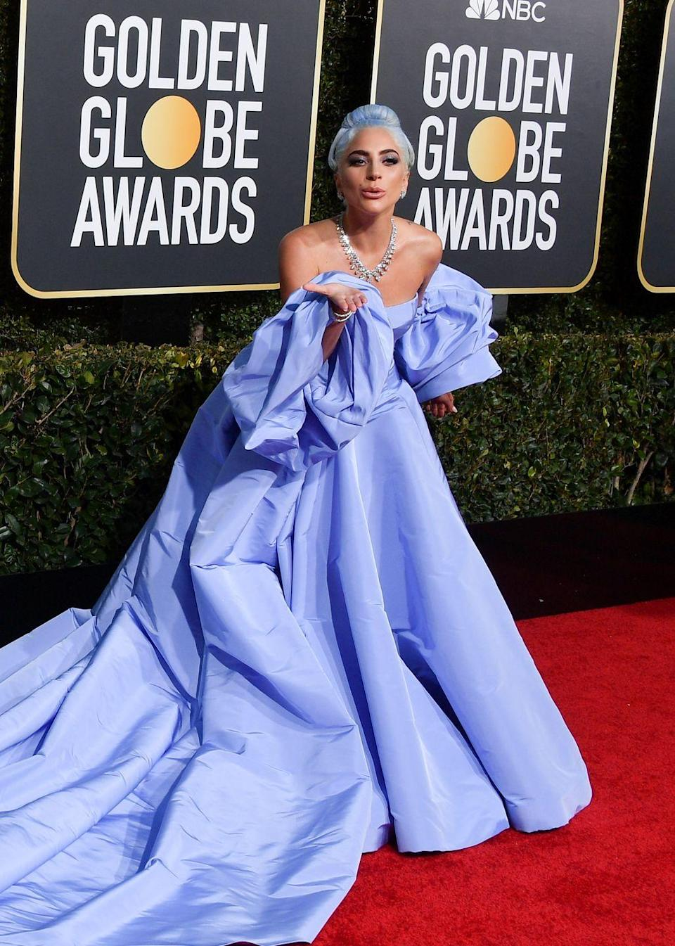 """<p>2019 was quite the year for Lady Gaga, which saw her scooping countless awards for A Star is Born. It also saw her upping her game fashion-wise in a series of high-octane gowns, culminating in her <a href=""""https://www.harpersbazaar.com/uk/fashion/fashion-news/a27386074/lady-gaga-strip-tease-met-gala/"""" rel=""""nofollow noopener"""" target=""""_blank"""" data-ylk=""""slk:striptease entrance at the Met Gala."""" class=""""link rapid-noclick-resp"""">striptease entrance at the Met Gala.</a> However, her red carpet highlight was this sky-blue Valentino couture dress that she wore to the Golden Globes. Gaga's gown<a href=""""https://www.harpersbazaar.com/uk/fashion/fashion-news/a25771495/lady-gaga-judy-garland-dress-tribute-accident/"""" rel=""""nofollow noopener"""" target=""""_blank"""" data-ylk=""""slk:resembled a dress that Judy Garland"""" class=""""link rapid-noclick-resp""""> resembled a dress that Judy Garland</a> wore in the original 1954 version of A Star is Born - the role for which Gaga was nominated. She later said that the comparison was actually a happy accident, but admitted that """"it looks an awful lot like it, doesn't it?""""</p>"""