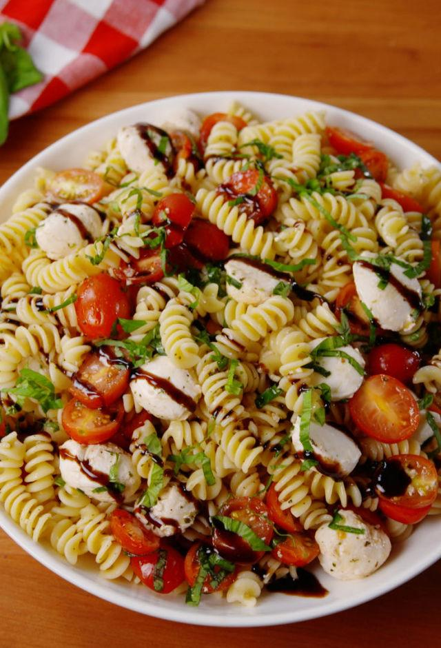 """<p>We'll eat anything topped with balsamic drizzle, but especially this.</p><p>Get the recipe from <a rel=""""nofollow"""" href=""""http://www.delish.com/cooking/recipe-ideas/recipes/a53227/caprese-pasta-salad-recipe/"""">Delish</a>.</p>"""