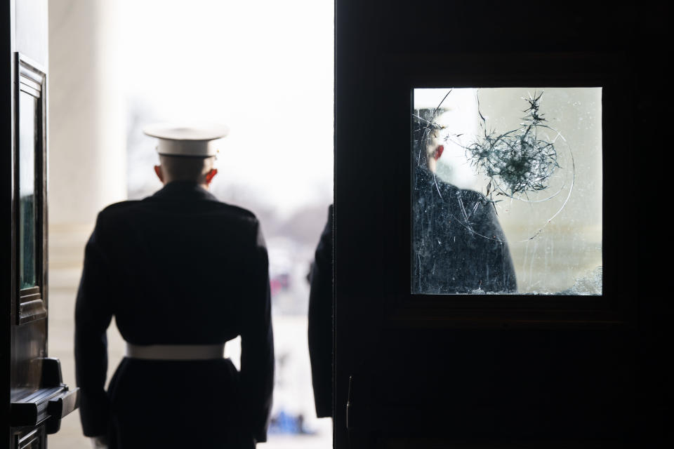 U.S. Marine Corps. sentries outside a damaged door at the Capitol during a rehearsal for the 59th inaugural ceremony for President-elect Joe Biden and Vice President-elect Kamala Harris on Monday, January 18, 2021 at the U.S. Capitol in Washington. (Jim Lo Scalzo/Pool via AP)