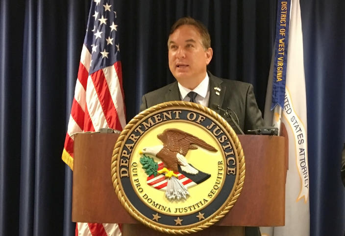 U.S. Attorney Mike Stuart speaks at a news conference, Wednesday, July 31, 2018, at the federal courthouse in Charleston, W.Va. Stuart announced that retired West Virginia Supreme Court Justice Menis Ketchum has agreed to plead guilty to a felony as part of an ongoing investigation of the state's high court. (AP Photo/John Raby)