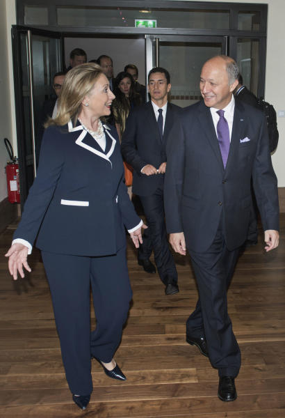 US Secretary of State Hillary Clinton, left, walks with French Foreign Minister Laurent Fabius before their meeting in Paris, Friday July 6, 2012. Syrian opposition leaders are pressing diplomats at an international conference for a no-fly zone over Syria, but the U.S. and its European and Arab partners are expected to focus on economic sanctions instead. (AP Photo/Brendan Smialowski, Pool)