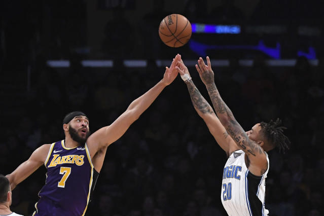 Orlando Magic guard Markelle Fultzm, right, shoots as Los Angeles Lakers center JaVale McGee defends during the first half of an NBA basketball game Wednesday, Jan. 15, 2020, in Los Angeles. (AP Photo/Mark J. Terrill)