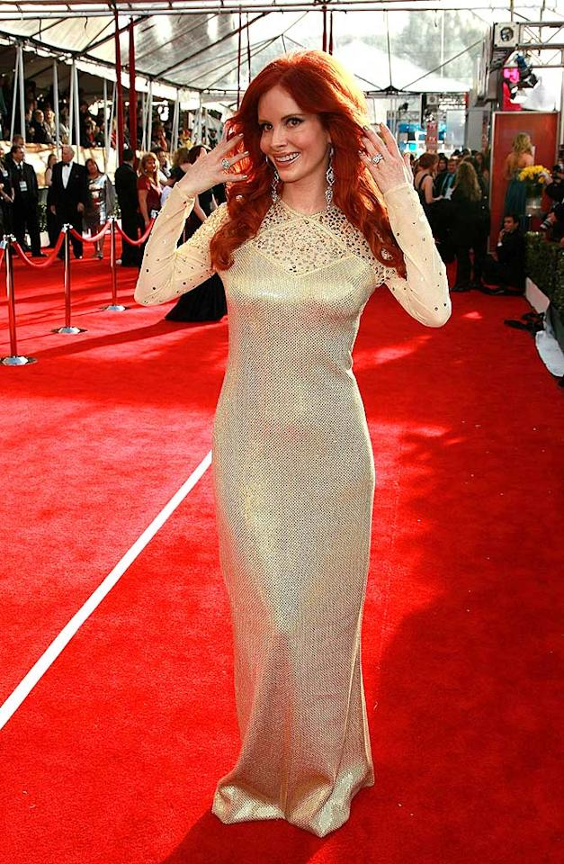 "Struggling ""actress"" Phoebe Price, best known for staging photo ops at gas stations and valet lines throughout Beverly Hills, strikes a pose in a grotesque gown adorned with beige bejeweled sleeves. Dimitrios Kambouris/<a href=""http://www.wireimage.com"" target=""new"">WireImage.com</a> - January 27, 2008"
