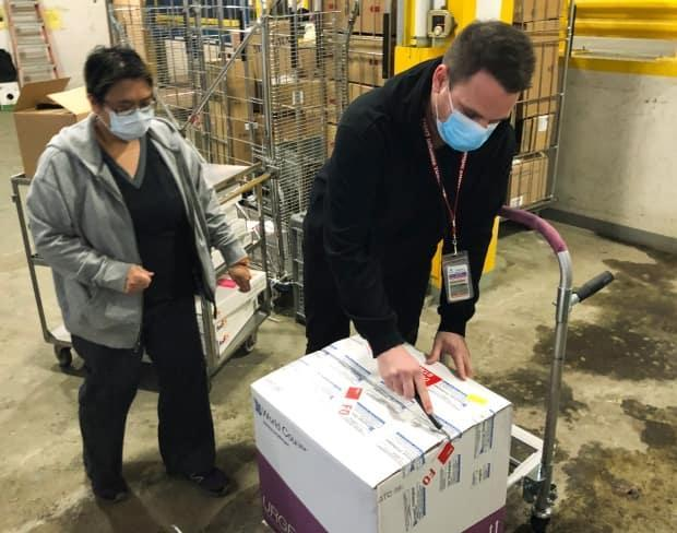 The first delivery of the Moderna COVID-19 vaccine arrives in Calgary in late December. (Alberta Health Services - image credit)