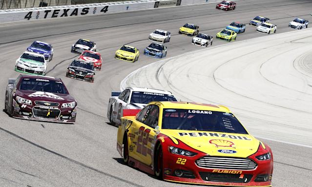 Sprint Cup Series driver Joey Logano (22) leads the pack during the NASCAR Sprint Cup series auto race at Texas Motor Speedway, Monday, April 7, 2014, in Fort Worth, Texas. (AP Photo/Mike Stone)