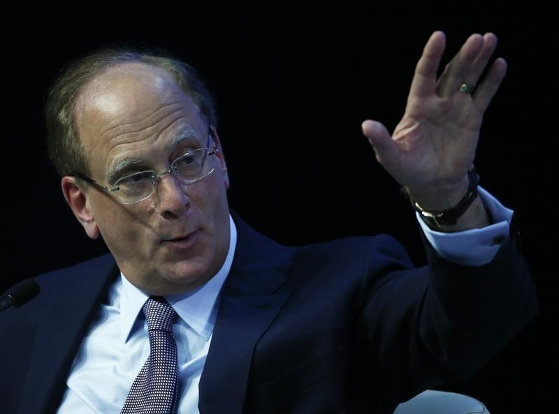 Fink, Chairman and CEO of Blackrock Inc., gestures at the session 'The Global Economic Outlook' in the Swiss mountain resort of Davos