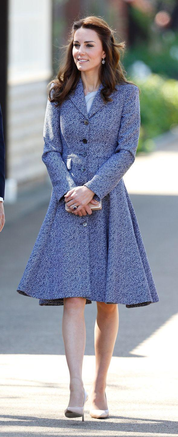 <p>She wore the coat dress again to open the Magic Garden at Hampton Court Palace in London.</p>