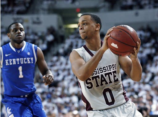 Mississippi State guard Jalen Steele (0) looks for an open man while Kentucky guard Darius Miller (1) defends in the second half of an NCAA college basketball game in Starkville, Miss., Tuesday, Feb. 21, 2012. No. 1 Kentucky won 73-64. (AP Photo/Rogelio V. Solis)