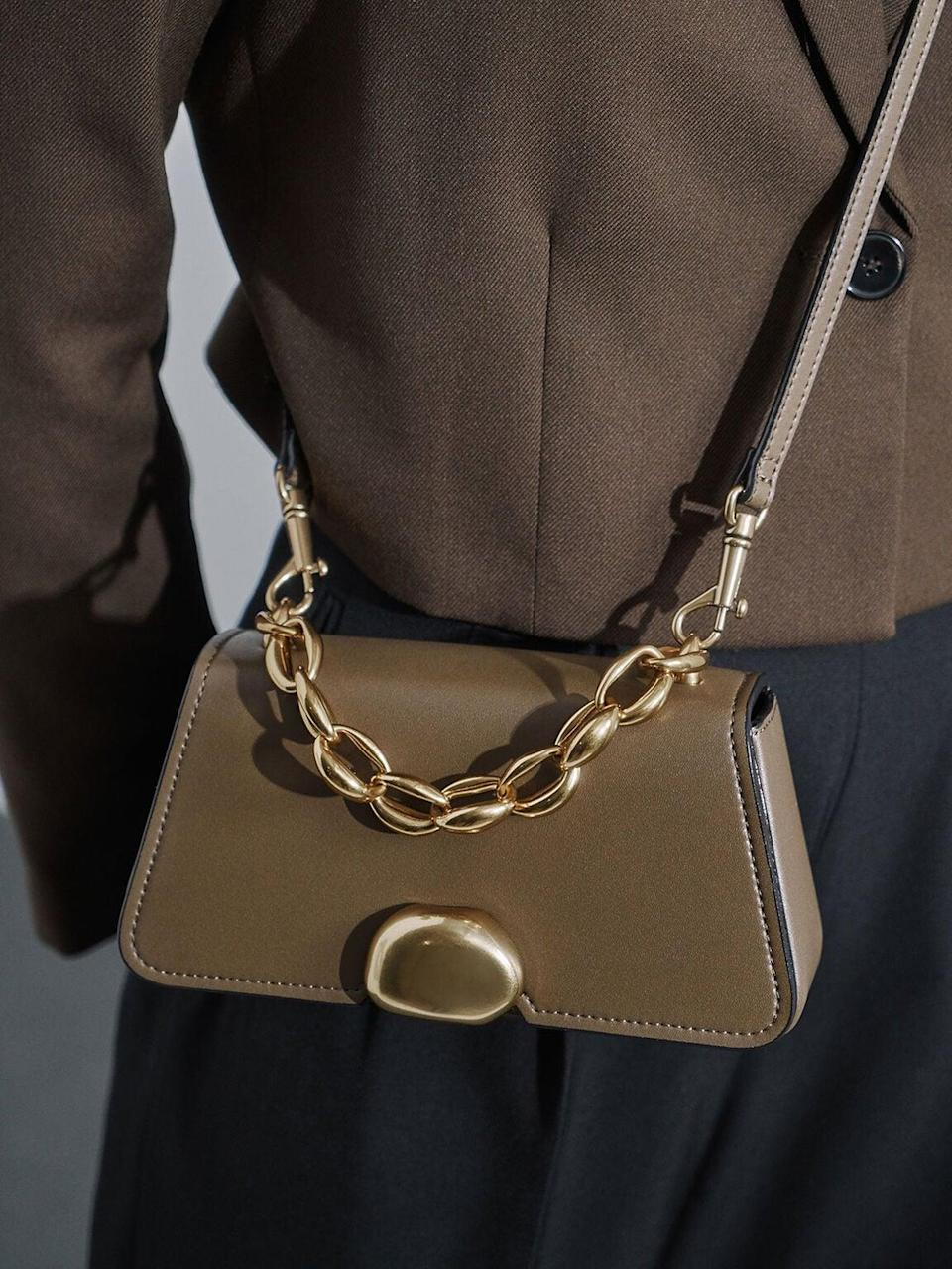 <p>This <span>Charles &amp; Keith Metallic Chain Top Handle Bag</span> ($56) looks a lot more expensive than it is.</p>