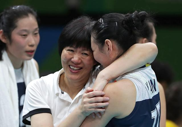 2016 Rio Olympics - Volleyball - Women's Semifinals China v Netherlands - Maracanazinho - Rio de Janeiro, Brazil - 18/08/2016. Coach Ping Lang (CHN) of China celebrates victory with Yan Ni (CHN) of China. REUTERS/Ricardo Moraes FOR EDITORIAL USE ONLY. NOT FOR SALE FOR MARKETING OR ADVERTISING CAMPAIGNS.