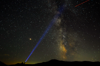 <p>A stargazer in Macedonia shines a beam of light into the dazzling night sky (Reuters) </p>