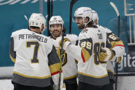 Vegas Golden Knights right wing Alex Tuch (89) celebrates with teammates after scoring a goal against the San Jose Sharks during the second period of an NHL hockey game in San Jose, Calif., Saturday, March 6, 2021. (AP Photo/Jeff Chiu)