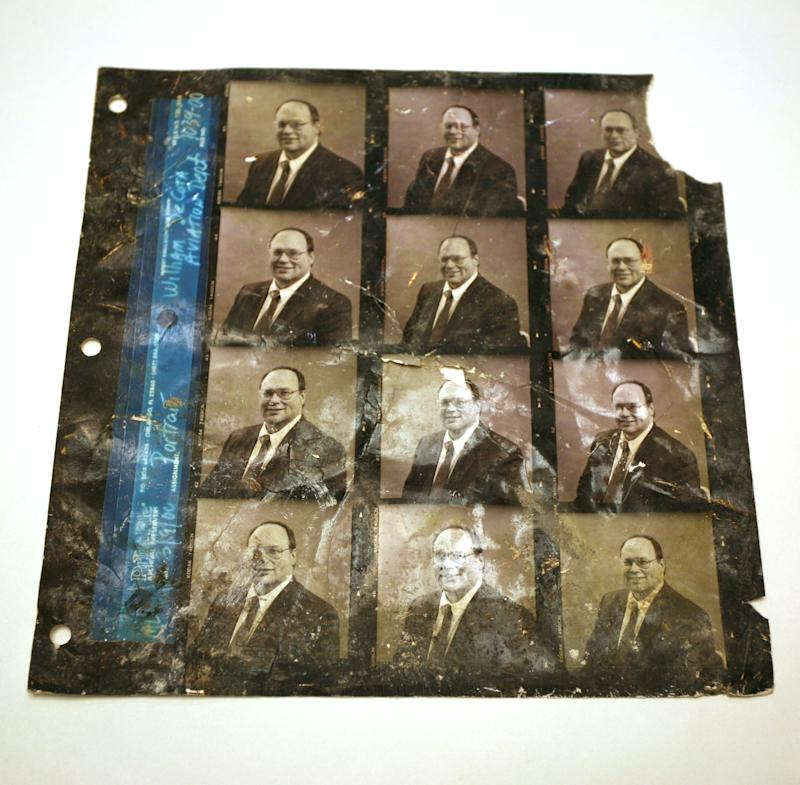 In this undated photo provided by the National September 11 Memorial & Museum, a damaged photographer's proof sheet, with photos of William DeCosta, the aviation Director of the Port Authority of New York and New Jersey is shown. The document was found by a recovery worker a few blocks away from ground zero and he eventually traced it to DeCosta, who continued to work for the Port Authority until his death about 2 years ago. Besides ending nearly 3,000 lives, destroying planes and reducing buildings to tons of rubble and ash, the Sept. 11, 2001, attacks destroyed tens of thousands of records, irreplaceable historical documents and art.  (AP Photo/National September 11 Memorial & Museum)